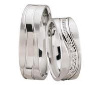 Christian Diamanten trouwringen gedraaid model wit goud
