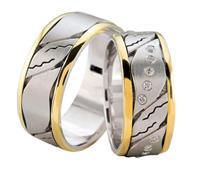 Christian Trouwringen bicolor diagonaal diamanten geel goud
