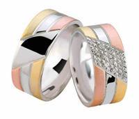 Christian Tricolor trouwringen met diamanten geel goud