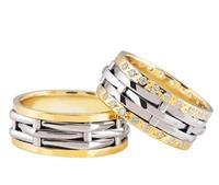 Christian Bicolor trouwringen met 2 rijen diamanten geel goud