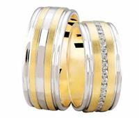 Christian Bicolor trouwringen met 0.37 ct. diamanten geel goud